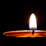 Single candlelight in the darkness